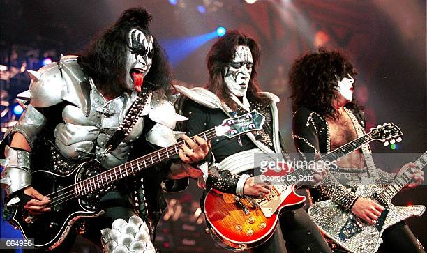 Bass player Gene Simmons lead guitarist Ace Frehley and rhythm guitarist and vocalist Paul Stanley of the rock group ''KISS'' perform live June 27...