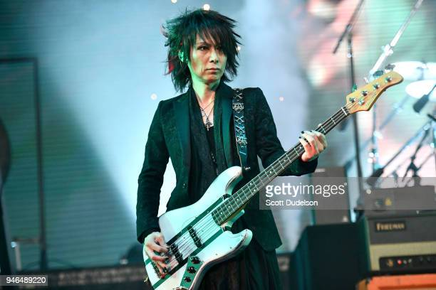 Bass player Heath of the band X Japan performs on the Sahara stage during week 1 day 2 of the Coachella Valley Music and Arts Festival on April 14...