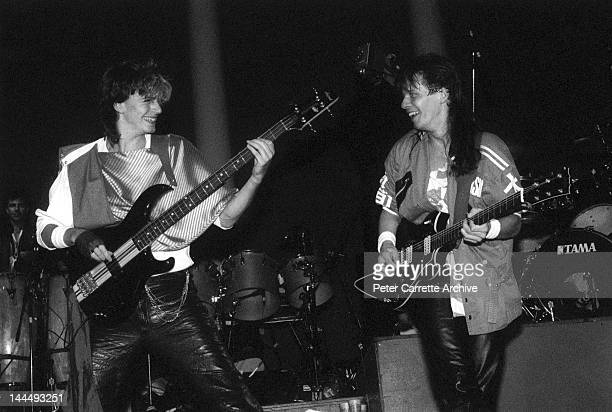 Bass player John Taylor and guitarist Andy Taylor performing live on stage with the band 'Duran Duran' during a concert in 1984 in New York City