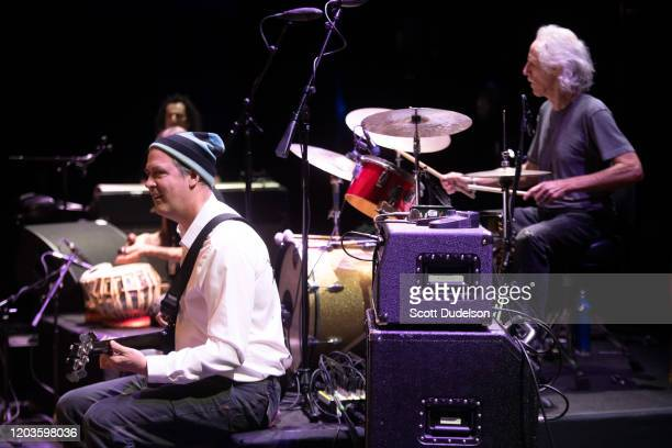 Bass player Krist Novoselic of Nirvana and Drummer John Densmore founding member of The Doors perform onstage during Homeward Bound A Benefit for the...