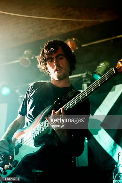 Bass player on stage with rock band