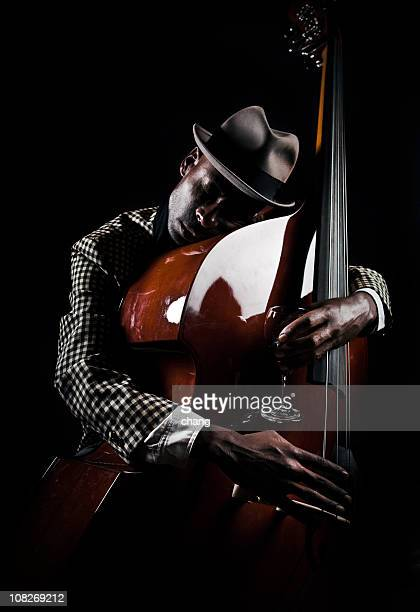 bass player - jazz stock pictures, royalty-free photos & images
