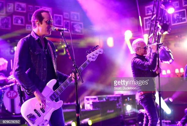 Bass player Robert DeLeo and singer Jeff Gutt of Stone Temple Pilots performs onstage during a live taping of ATT AUDIENCE Network Music Series at...