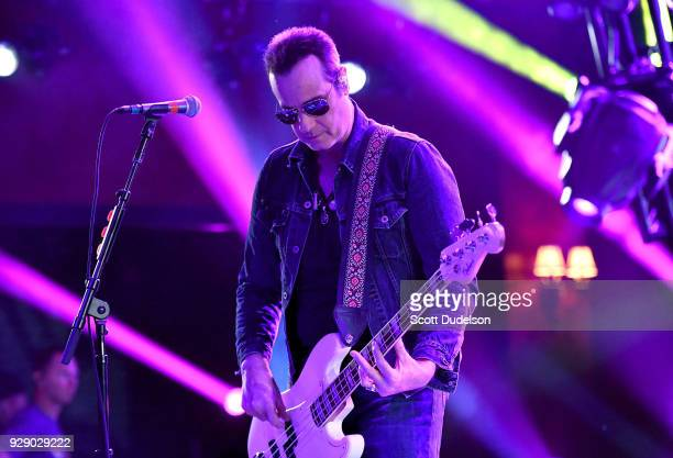 Bass player Robert DeLeo founding member of Stone Temple Pilots performs onstage during a live taping of ATT AUDIENCE Network Music Series at Red...