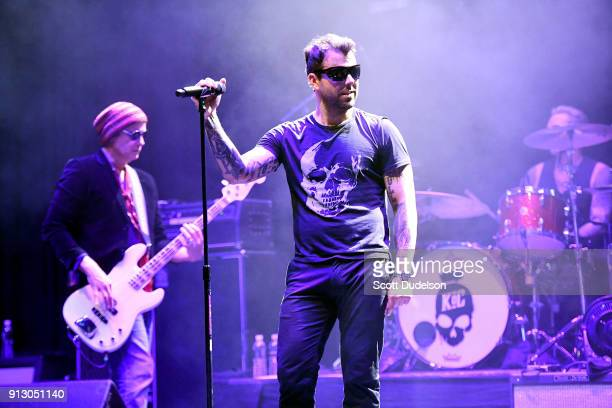Bass player Robert DeLeo of Stone Temple Pilots and singer Franky Perez of Kings of Chaos perform onstage during the Adopt the Arts annual rock gala...