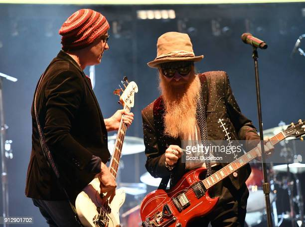 Bass player Robert DeLeo of the band Stone Temple Pilots and singer/guitarist Billy Gibbons of the band ZZ Top perform onstage during the Adopt The...