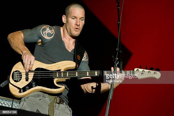 Bass player Tim Commerford of American band Rage Against The Machine performs on stage playing Lakland bass at the Reading Festival England on August...