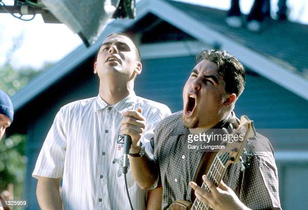 Bass player Tye Zamora of Alien Ant Farm lets out a heart felt yell as singer Dryden Mitchell right gives the camera a cold stare during the filming...