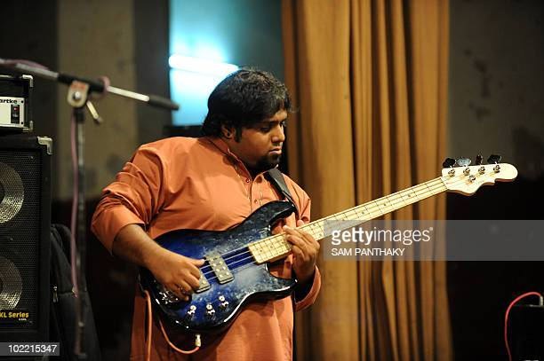 Bass player Wilson Kenneth from Moon Arra Fusion Band group performs at the Town Hall in Ahmedabad late June 18 2010 Moon Arra has since 2006...
