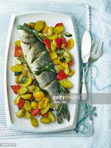 bass with rosemary and vegetables for christmas - perch fish stock pictures, royalty-free photos & images