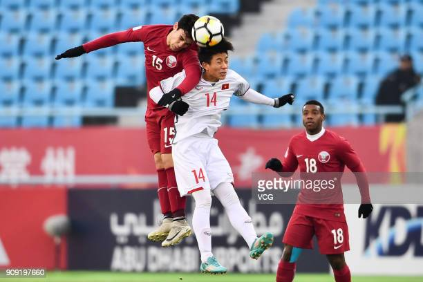 Bassam Al Rawi of Qatar and Phan Van Duc of Vietnam compete for the ball during the AFC U23 Championship semifinal match between Qatar and Vietnam at...