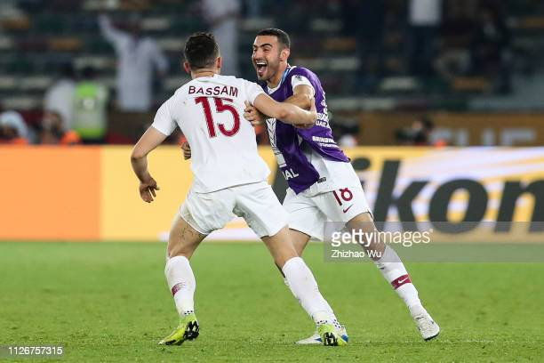 Bassam Alrawi and Abdulkareem Salem AlAli of Qatar celebrate the victory after the AFC Asian Cup final match between Japan and Qatar at Zayed Sports...