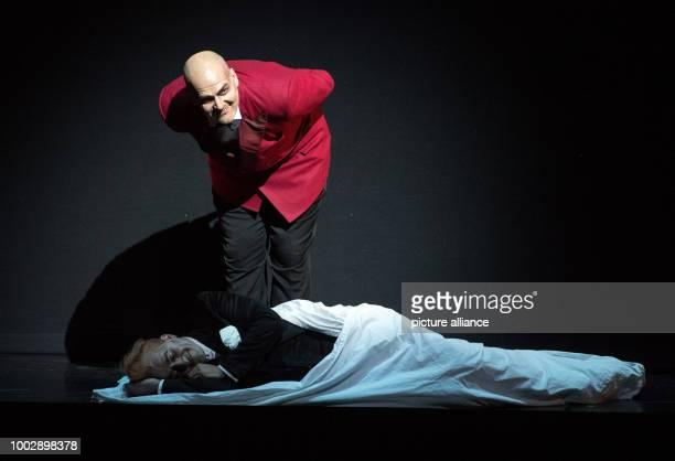Bassbaritone Florian Boesch as Mephistopheles and tenor Charles Castronovo as Faust perform during the photo rehearsal of 'La damnation de Faust' a T...