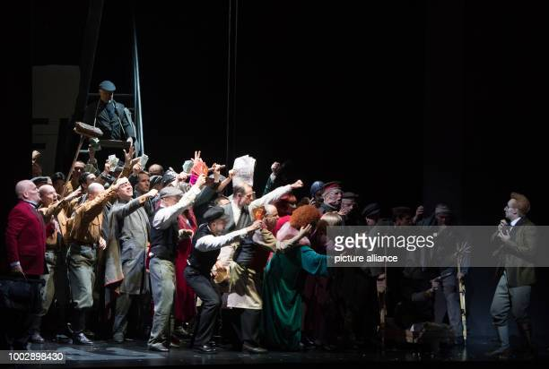 Bassbaritone Florian Boesch as Mephistopheles and tenor Charles Castronovo as Faust as well as the cast of the State Opera perform during the photo...