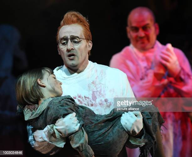 Bassbaritone Florian Boesch portraying Mephistopheles and tenor Charles Castronovo portraying Faust perform on stage during a photocall of 'La...