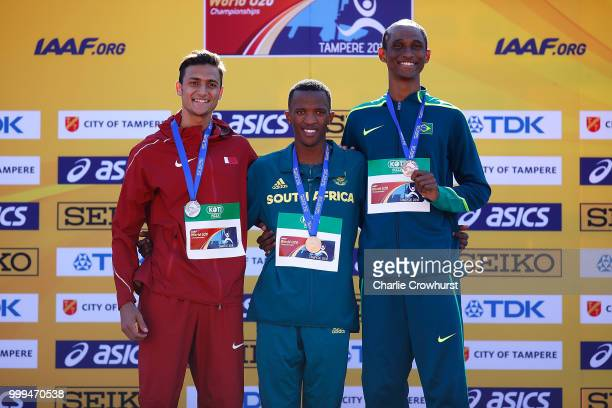 Bassem Hemeida of Qatar Sokwakhana Zazini of South Africa and Alison Dos Santos of Brazil celebrate with their medals during the medal ceremony for...