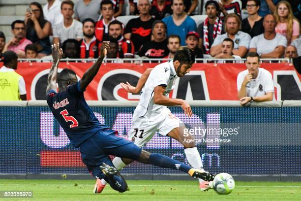 Bassem Srarfi of Nice and Davinson Sanchez of Ajax during the UEFA Champions League Qualifying match between Nice and Ajax Amsterdam at Allianz...