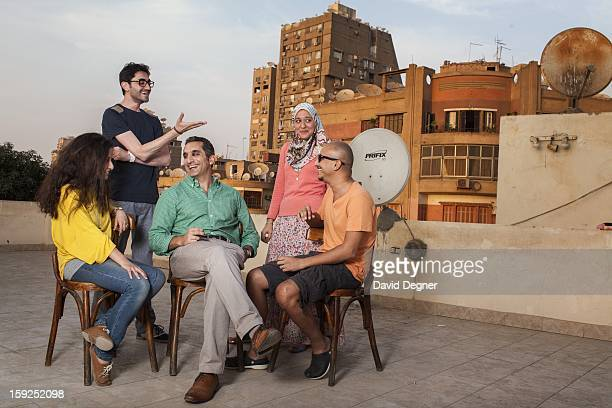 Bassem Youssef sits with some of his researchers and writers on top of their temporary offices while their new offices are being renovated on October...