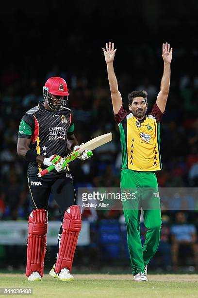 Basseterre Saint Kitts and Nevis 30 June 2016 Sohail Tanvir right of Guyana Amazon Warriors celebrates the wicket of Carlos Brathwaite of St Kitts...