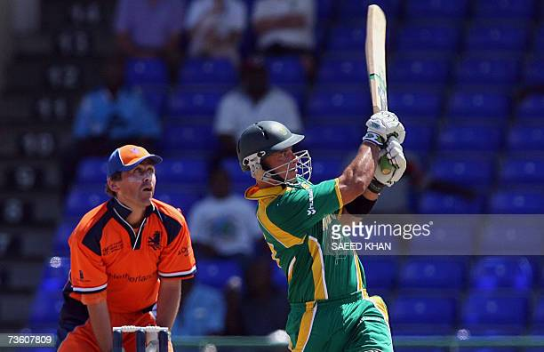 Basseterre St Kitts SAINT KITTS AND NEVIS South African cricketer Herschelle Gibbs plays for his fourth sixer out of the boundary off the Netherlands...