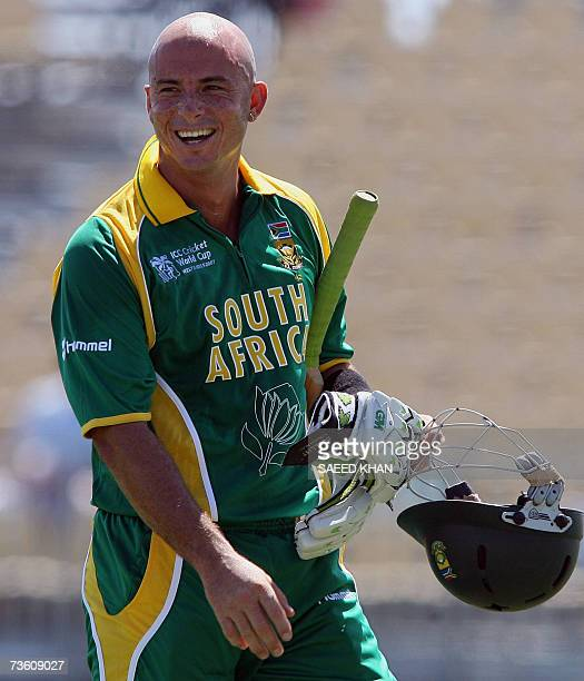 Basseterre St Kitts SAINT KITTS AND NEVIS South African cricketer Herschelle Gibbs smiles while heading back to the dressing room after an inning of...