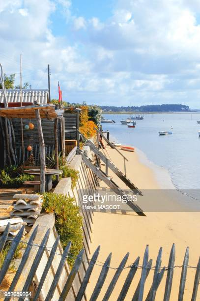 Bassin Arcachon's traditional village with wooden stair to acess on the beach