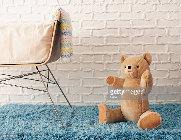 Bassinet and Teddy Bear in Baby's Room