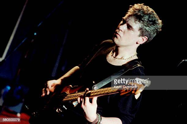 Bassist Adam Clayton performing with Irish rock group U2 at Leeds University 18th March 1983