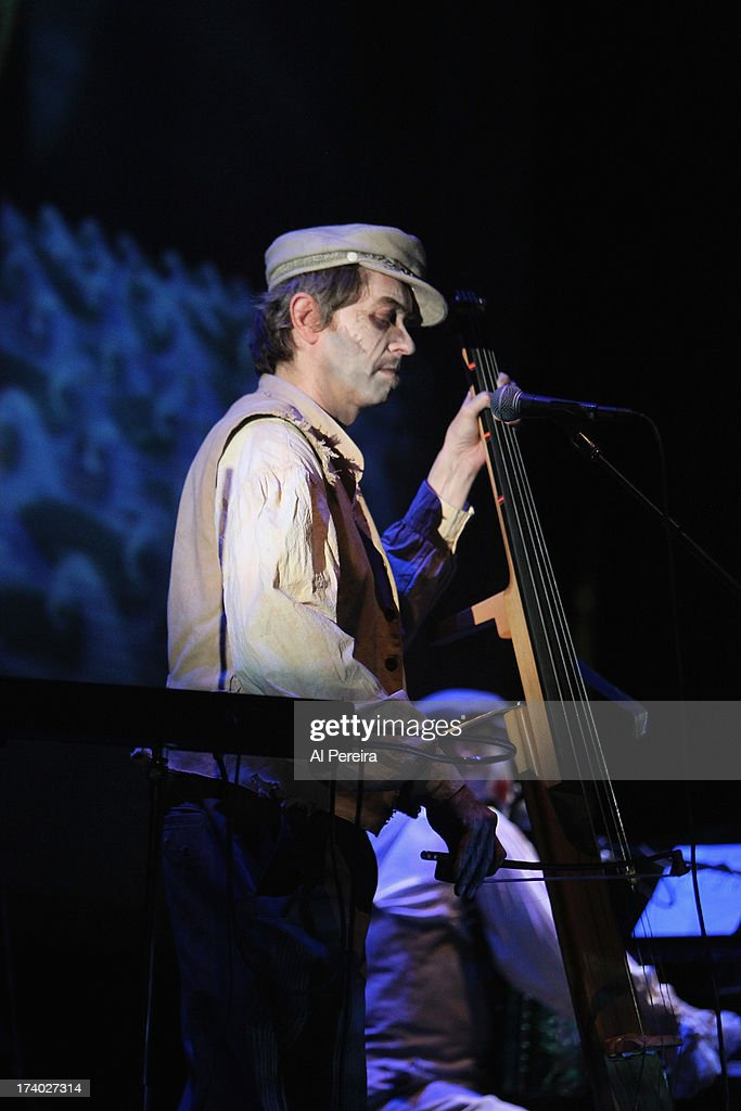 Bassist Adrian Stout of The Tiger Lillies perform 'Rime of the Ancient Mariner' during Celebrate Brooklyn! at Prospect Park Bandshell on July 18, 2013 in the Brooklyn borough of New York City. The Tiger Lillies stage set included screens and moving projections.