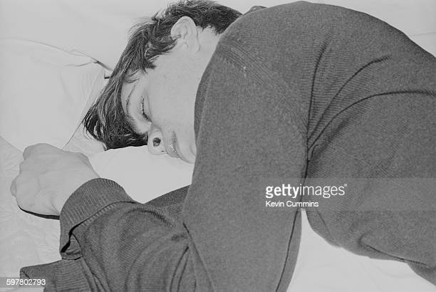 Bassist Alex James of English pop group Blur sleeping Tokyo 2nd March 1992