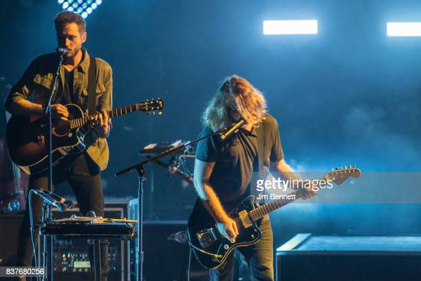 Bassist and cellist Brent Kutzle and guitarist Drew Brown of OneRepublic perform live on stage at White River Amphitheatre on August 22 2017 in...