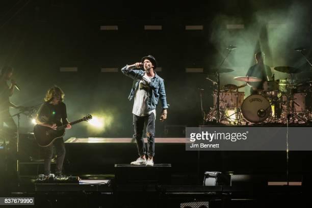 Bassist and cellist Brent Kutzle guitarist Drew Brown lead vocalist Ryan Tedder and drummer Eddie Fisher of OneRepublic perform live on stage at...