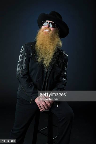 Bassist and covocalist with the American rock group ZZ Top Dusty Hill is photographed at the CMT Music Awards Wonderwall portrait studio on June 4...