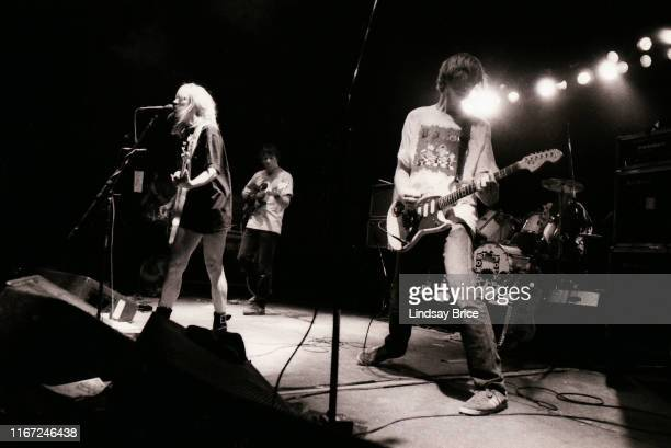 Bassist and vocalist Kim Gordon guitarist and vocalist Thurston Moore guitarist Lee Renaldo and drummer Steve Shelley perform in Sonic Youth on...