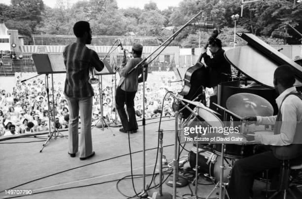 Bassist bandleader and composer Charles Mingus performs with the Charles Mingus Quintet at the Newport Jazz Festival New York in July 1973 in New...