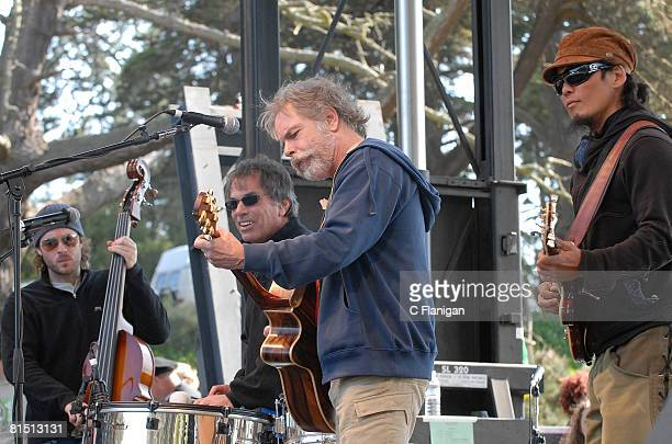 Bassist Ben Kaufmann Drummer Mickey Hart and Guitarist Bob Weir of the Grateful Dead with Michael Kang of the String Cheese Incident perform at the...