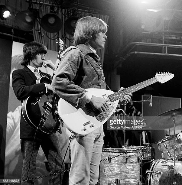 Bassist Bill Wyman and guitarist Brian Jones of The Rolling Stones during rehearsals for an episode of the Friday night TV pop/rock show 'Ready...