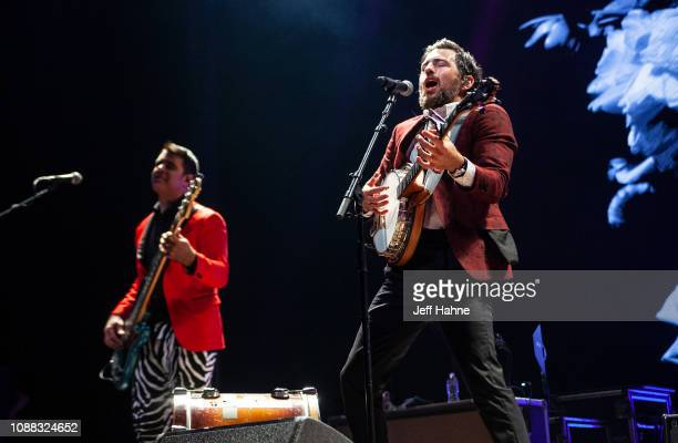 Bassist Bob Crawford and singer/banjo player Scott Avett of The Avett Brothers perform at Bojangles Coliseum on December 30 2018 in Charlotte North...