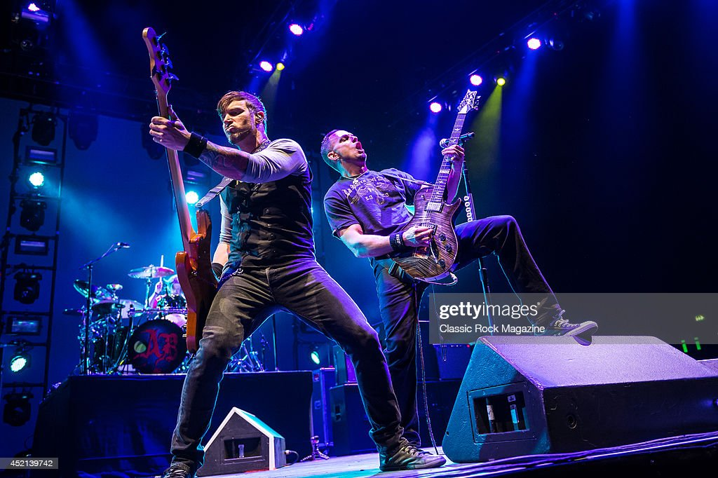 Bassist Brian Marshall (L) and guitarist Mark Tremonti of American rock group Alter Bridge performing live on stage at Wembley Arena in London, on October 18, 2013.