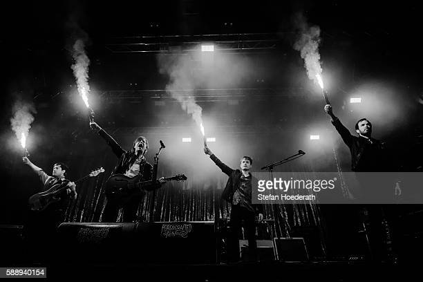 Bassist CarlJohan Fogelklou singer Bjoern Dixgard guitarist Jens Siverstedt and keyboarder Daniel Haglund of Mando Diao perform live on stage during...