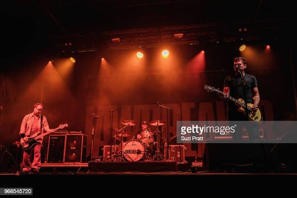 Bassist Chris Bauermeister drummer Adam Pfahler and lead guitarist and vocalist Blake Schwarzenbach of Jawbreaker performs live on stage during...