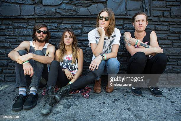 Bassist Chris Null guitarist Siouxsie Medley vocalist Emily Armstrong and drummer Sean Friday of Dead Sara pose backstage on day 3 of the Sunset...