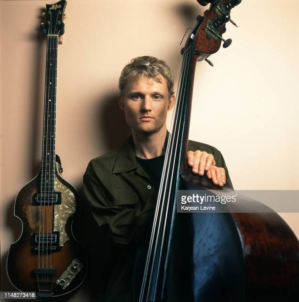 Bassist Chris Wood of jazz trio Modeski Martin and Wood poses for a portrait among his basses on July 1 1998 in New York City New York