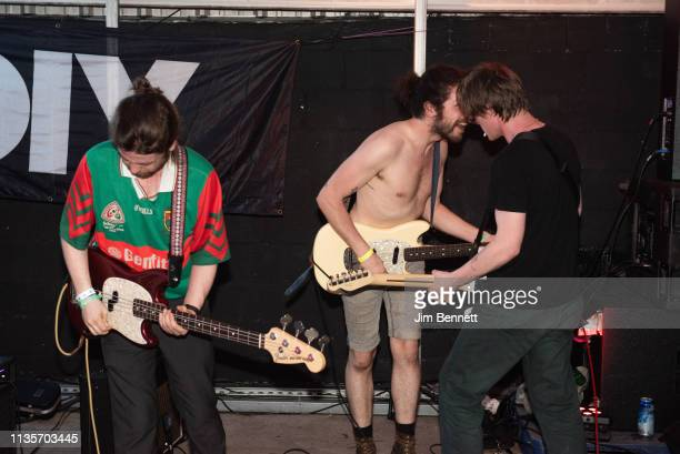 Bassist Conor Deegan , guitarist Carlos O'Connell and guitarist Conor Curley of Fontaines D.C. Perform live on stage during the 2019 SXSW Conference...