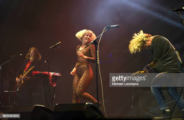 Bassist Daniel Gleason singer/keyboardist Hannah Hooper and guitarist Andrew Wessen of the band Grouplove perform at CocaCola Music during the NCAA...