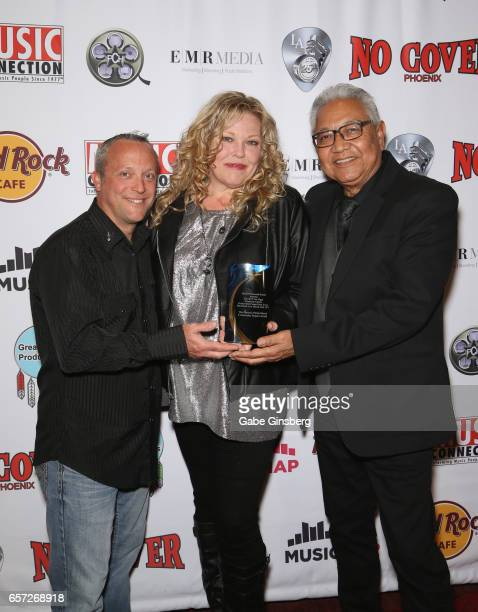 Bassist Darrin Ishan singer Amanda Adkins and saxophonist Tony 'TBone' Villegas of The Phoenix Patriot Band recipients of the Community Impact award...