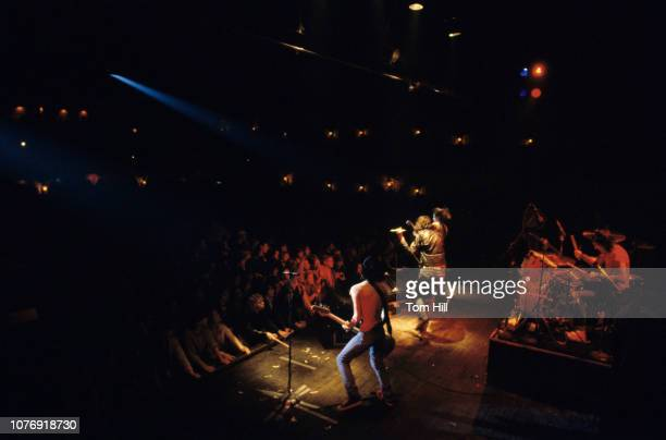 Bassist Dee Dee Ramone singer Joey Ramone guitarist Johnny Ramone and drummer Marky Ramone of the punk rock band The Ramones perform at The Agora...