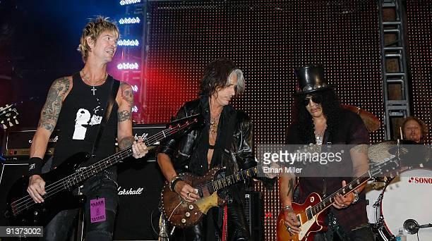 Bassist Duff McKagan Aerosmith guitarist Joe Perry guitarist Slash and drummer Matt Sorum perform during a concert at the Bare Pool Lounge at The...