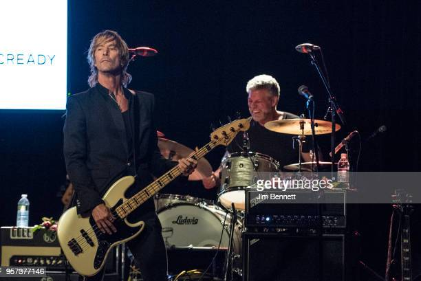 Bassist Duff McKagan and drummer Barrett Martin perform live on stage during the MusiCares Concert for Recovery benefit at The Showbox on May 10 2018...