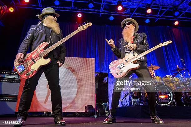 Bassist Dusty Hill and guitarist Billy Gibbons of ZZ Top perform on stage at Humphrey's on September 13 2015 in San Diego California
